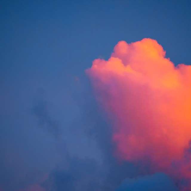 Clouds at Sunset in Dark Sky