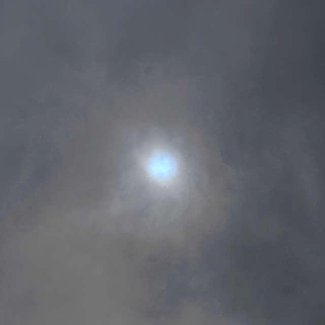 Blue Sun in Overcast Sky