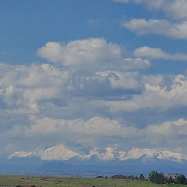 Pikes Peak, partly cloudy.