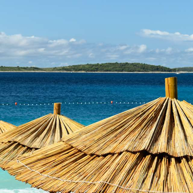 Sunshades on adriatic beach.