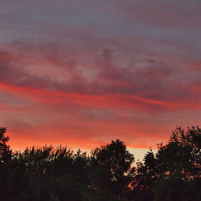 Orange red clouds at sunset