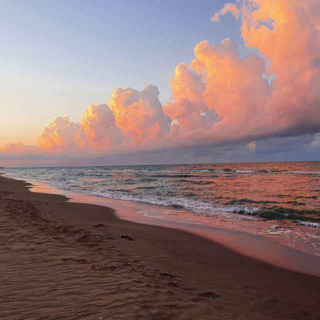 Amber clouds,waves and sands..