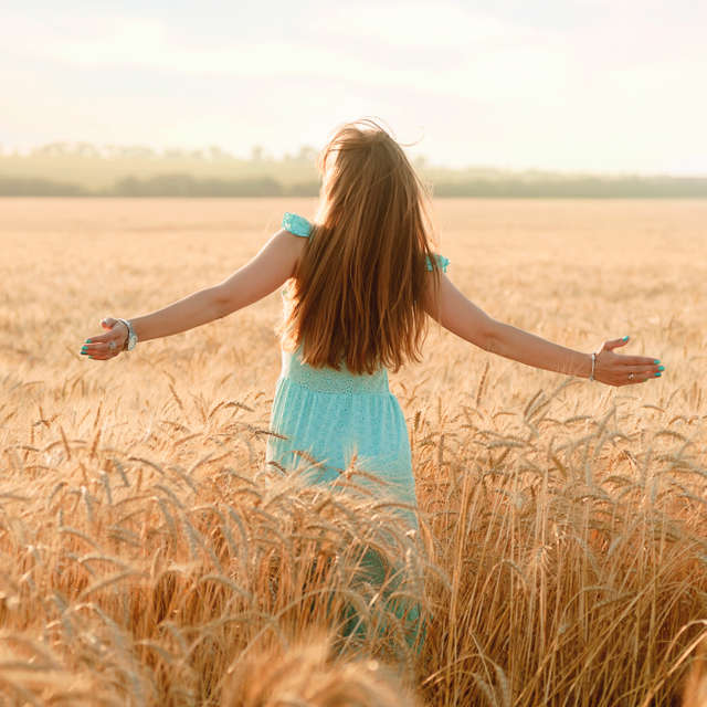 A girl in a field of wheat