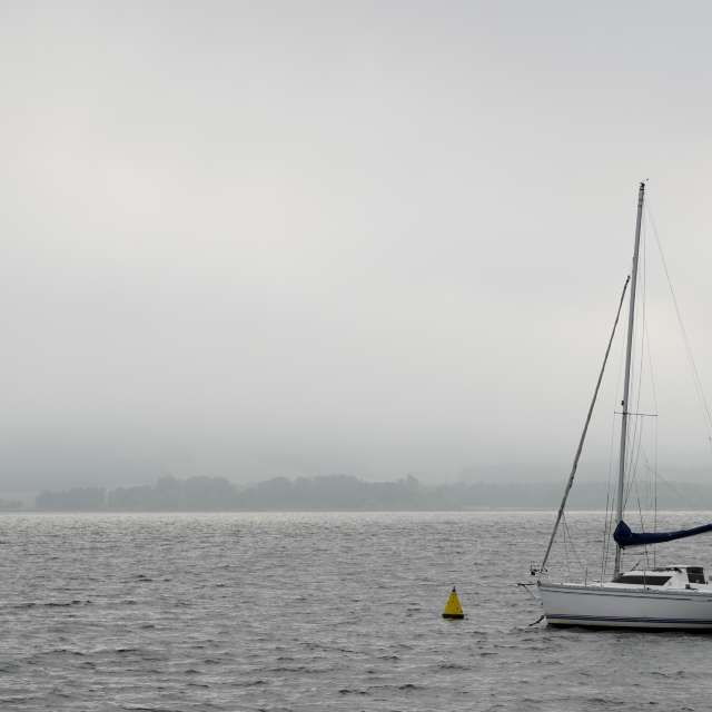 Yacht on the background of fog