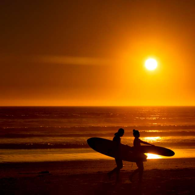 Surf Boarders at Sunset, BC,CA