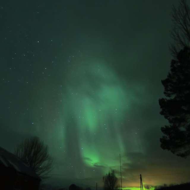 aurora through clouds