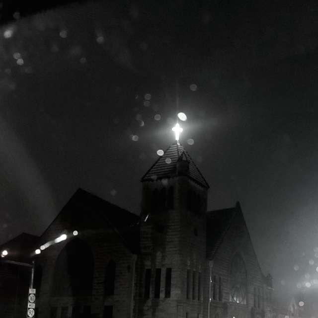 Old church glowing cross