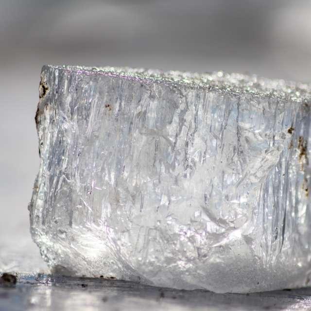 Frozen shiny ice cube melting
