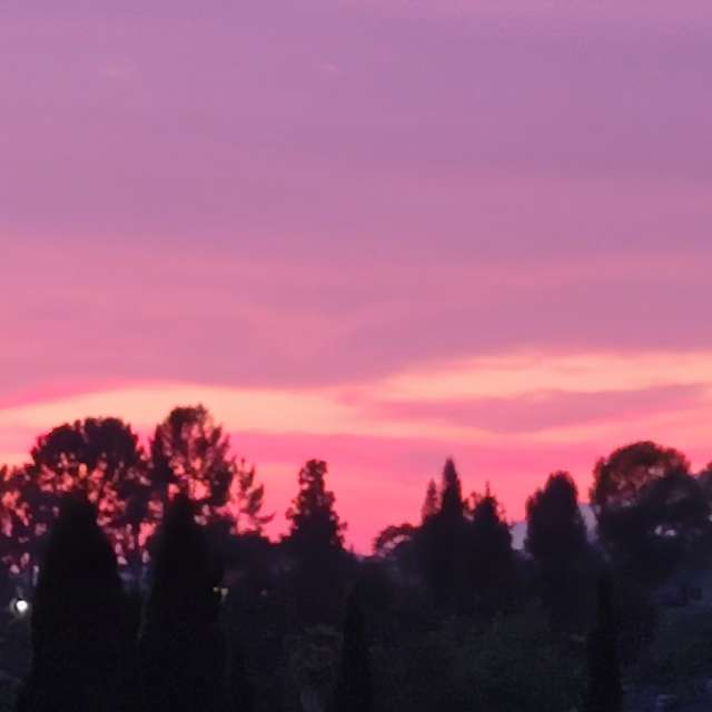 Two hearts in the purple sky