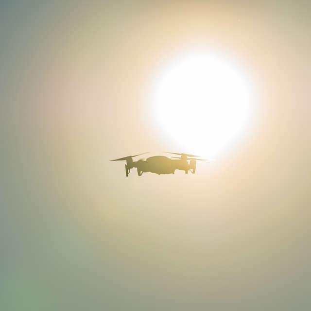 drone against the sun