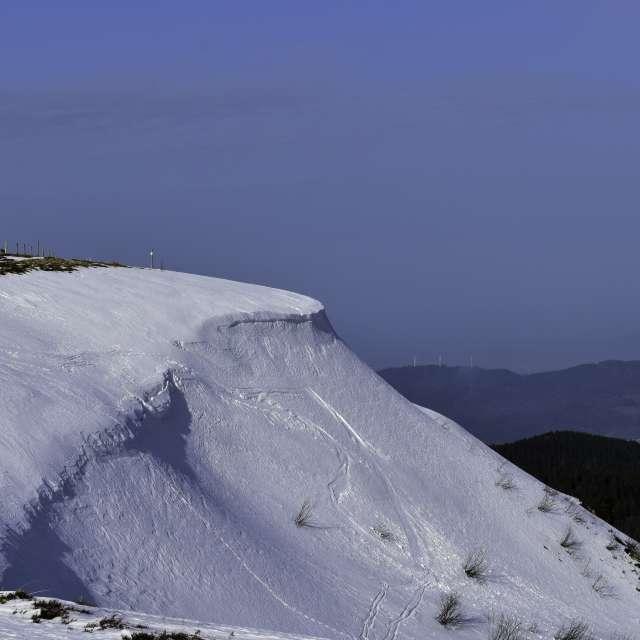 Snowdrift on mountain peak.