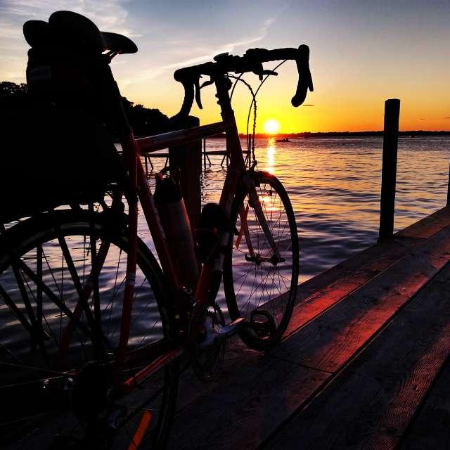 Bike on dock at sunset