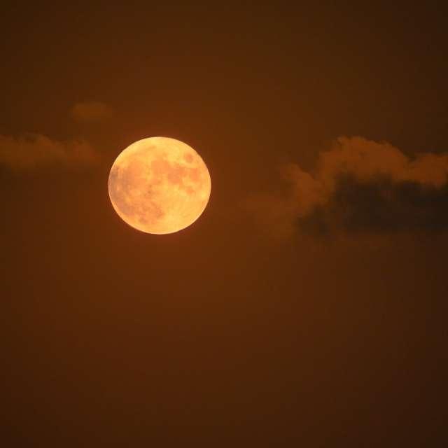 Moonrise between clouds Gozo,