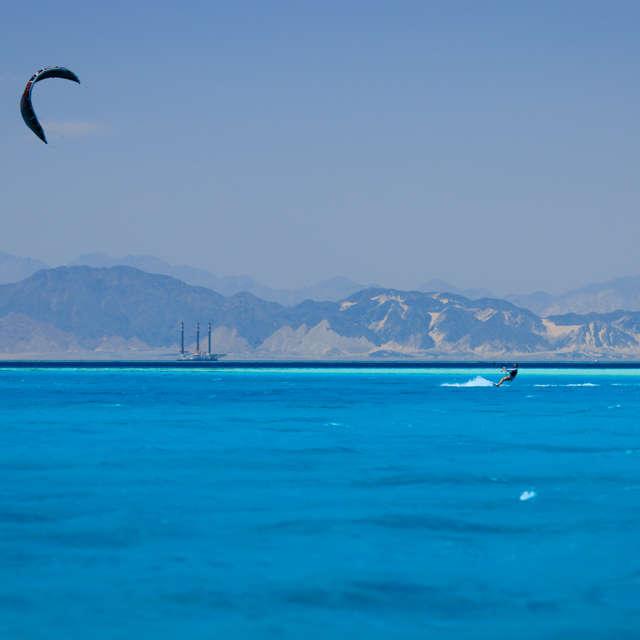 Kite sportsman and kite in sky