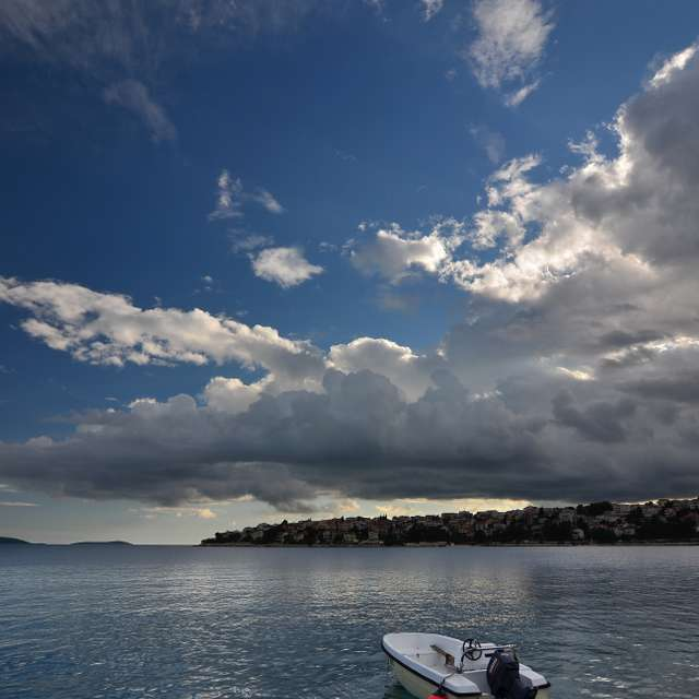 Alone boat under clouds