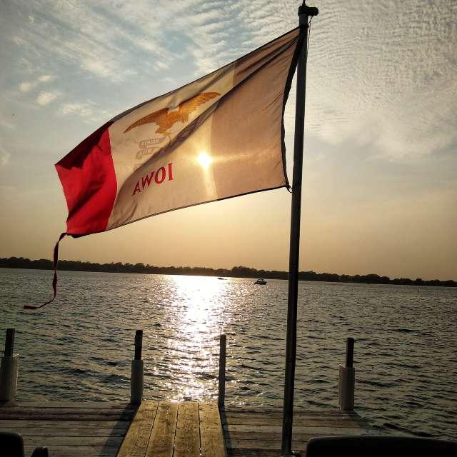 sunset through Iowa flag