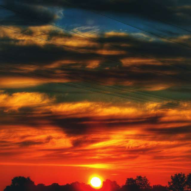 Rising Sun under Clouds