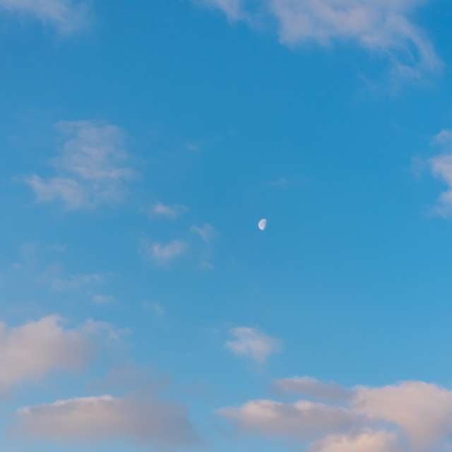 Moon and Clouds at Sunrise