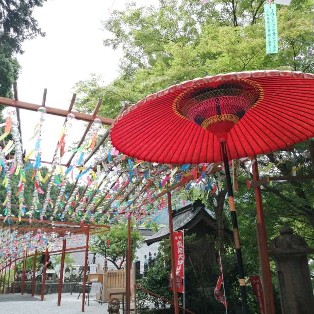 Wind chimes and red umbrella