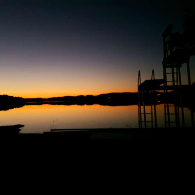 Sunset over fjord in Sweden