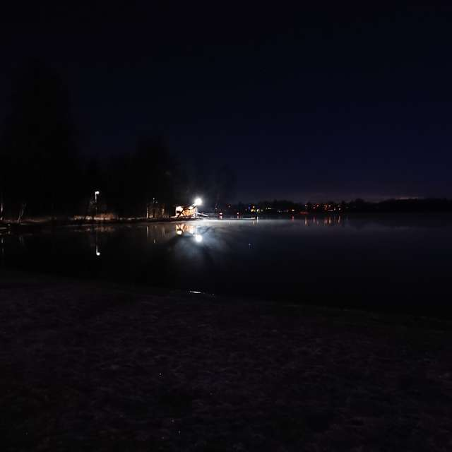 Steaming lake, lighted cabin