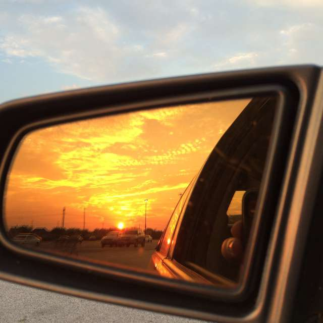 sunset in car mirror