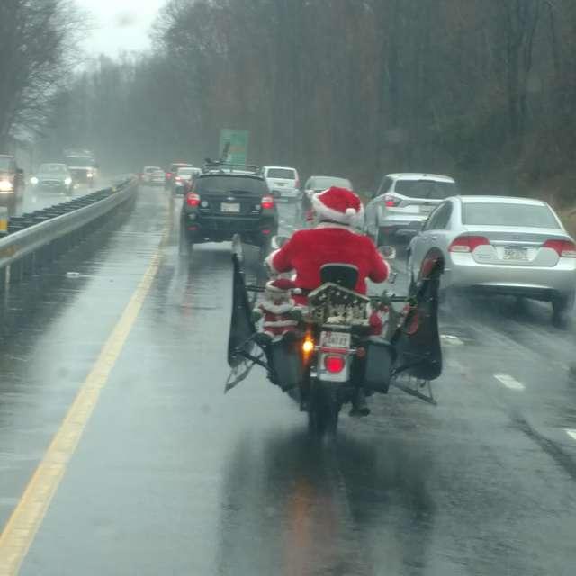 Santa on a bike in the rain