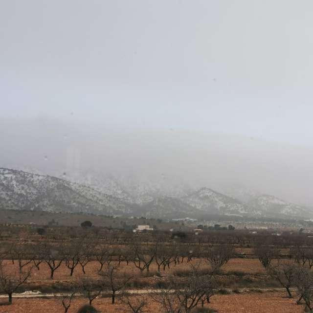 Snowy misty mountains