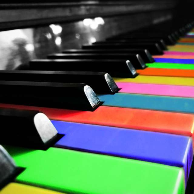 Piano with colorful keys.