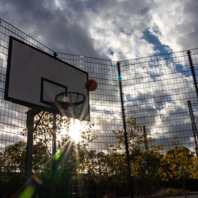 Flying Basketball in sun rays
